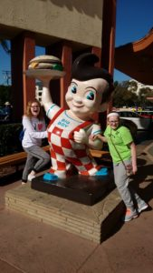 The girls posing next to the Big Boy statue